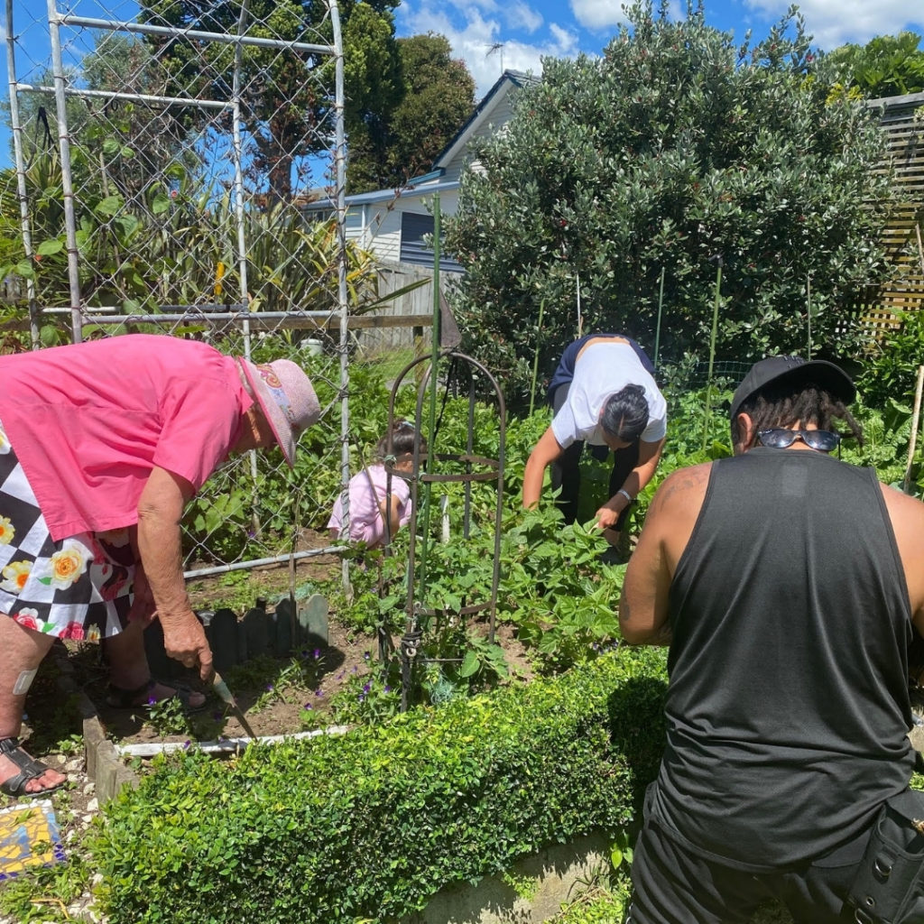 Tiana Ngawati, her nan and daughter, in the garden while being filmed